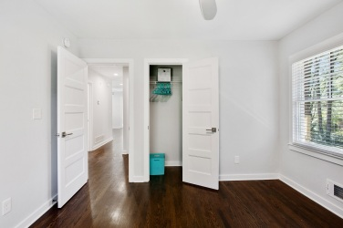22 small bedroom showing closet open and view to hallway